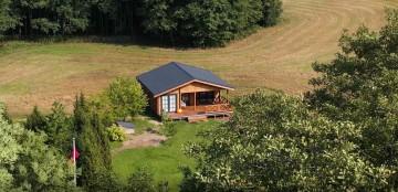 Timber cabins kuria namus, kuriuose norisi gyventi. Timber cabins nuotr.